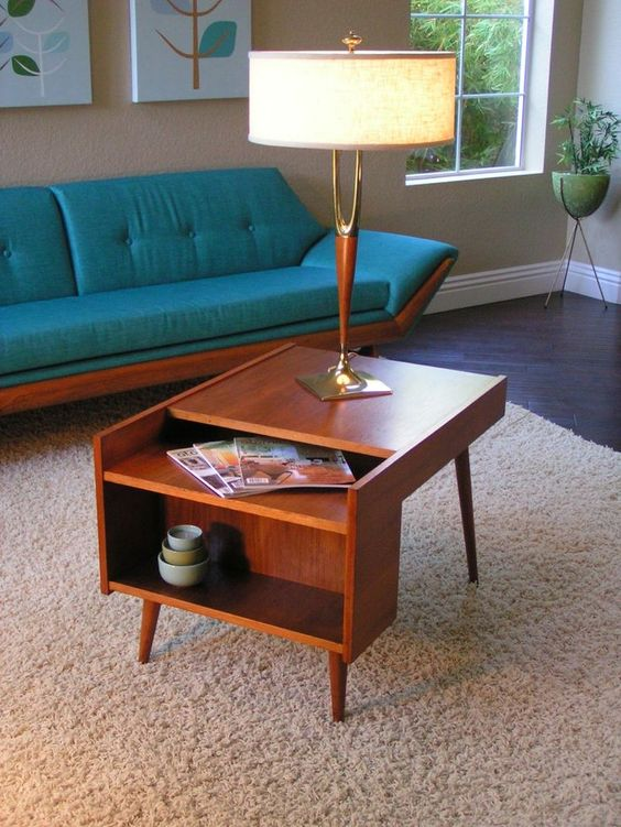 a lovely rich-stained mid-century modern coffee table with open storage compartments is a good idea for a nightstand, too