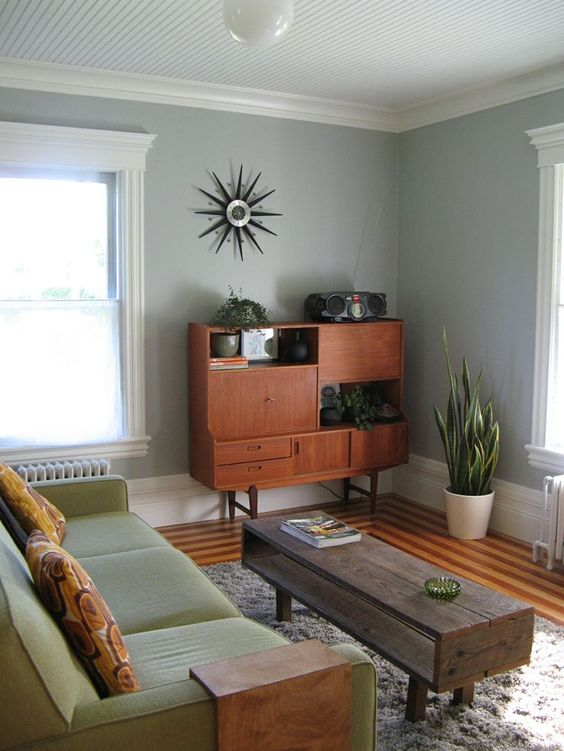 a mid-century modern coffee table of reclaimed wood, with rather dark stain and an open storage space