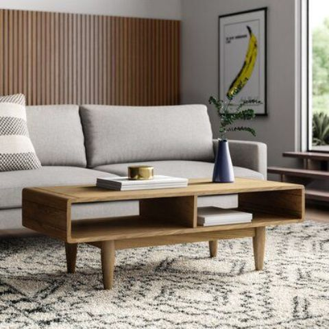 a pretty light-stained coffee table with two open storage compartments inside and tapered legs is a cool idea for a stylish living room