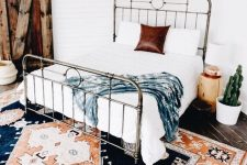 a retro metal bed like this one is a stylish solution for a modern or boho space