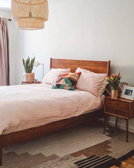 a rich stained mid-century modern bed and matching nightstands will make the space warming up and cozy