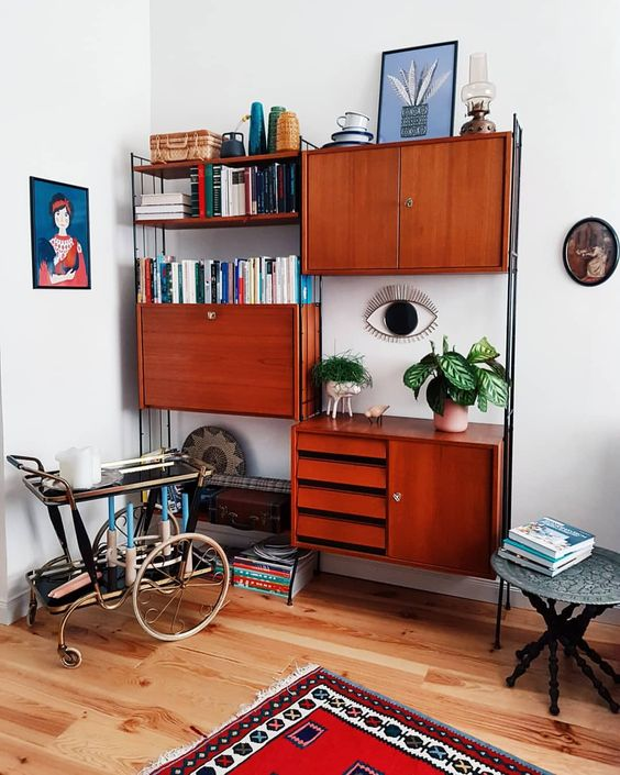 a rich stained teak wall unit with cabinets, drawers and some open shelves is a very comfy and practical unit