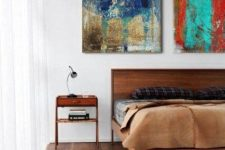 a rich-stained wooden bed and matching nightstands for a stylish and bold space in elegant mid-century modern style