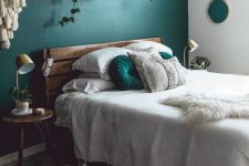 a rich-stained wooden bed with a plank headboard and matching nightstands for a mid-century modern space