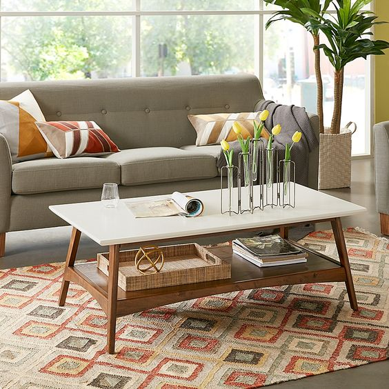 a simple and cool two tiered coffee table with a white and a stained tabletop is a chic and functional idea to rock in a mid-century modern living room