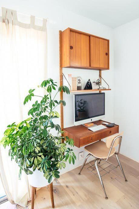a small wall-mounted unit with a closed cabinet, a shelf and a drawer that is used as a small desk
