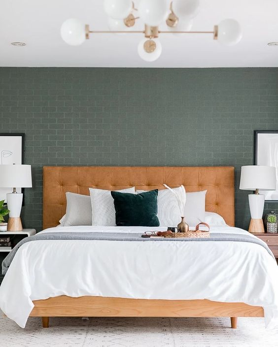 a stylish mid-century modern bed of wood and with a leather tufted headboard will make a warming statement in the space