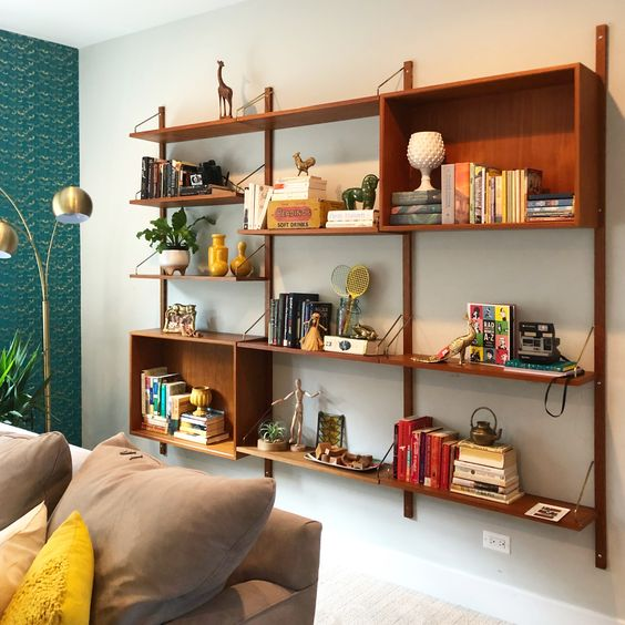 a wall-mounted storage unit with open shelves and open box shelves features a lot of storage space