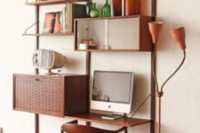 a whole mid-century modern wall-mounted system with open shelves and some cabinets plus a matching chair