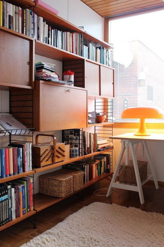 an oversized bookcase with open shelves and closed storage units is ideal for a mid-century modern home office