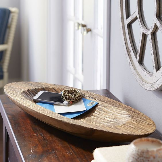 a carved vintage dough bowl as a trinket dish is a stylish way to add a touch of vintage