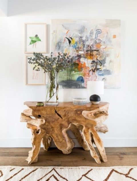 a console table of driftwood for a beach or seaside home entryway is a chic piece with a natural touch