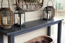 a dough bowl fiilled with pinecones is a stylish idea for a rustic entryway