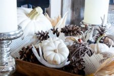 a dough bowl with pinecones, antlers, white pumpkins and acorns for fall home decor