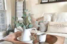 a dough bowl with vintage tableware and a fresh eucalyptus arrangement for a vintage farmhouse space