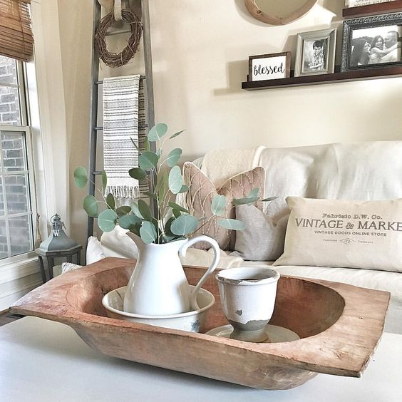 a dough bowl with vintage tableware and a fresh eucalyptus arrangement for a vintage farmhouse space