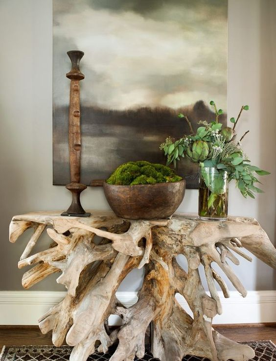 a driftwood console table is a budget-friendly piece that will bring an ocean feel to the space