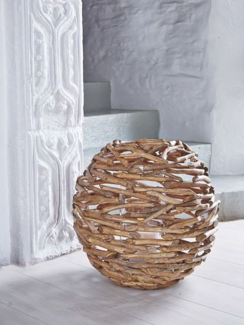 a large driftwood hurricane covered is a nice decor solution for any beach house