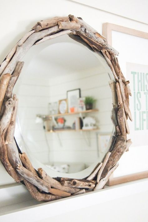 a round driftwood mirror is a cool idea to add a slight beachy feel to the space