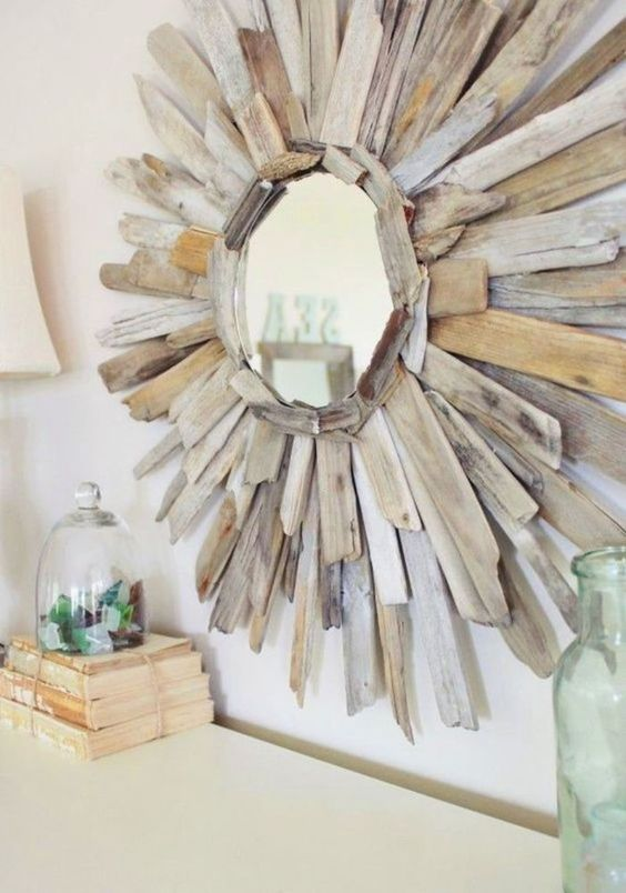 a small sunbrust mirror with lots of driftwood is a simple and very cute DIY