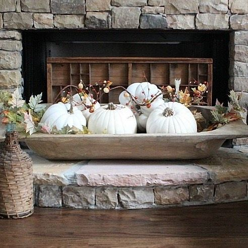 a vintage dough bowl with white pumpkins, faux leaves and berries for fall home decor