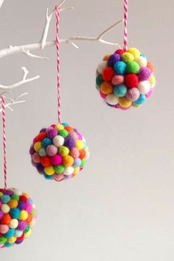 colorful pompom Christmas ornaments are bright decorations to make your Christmas tree funnier and cooler
