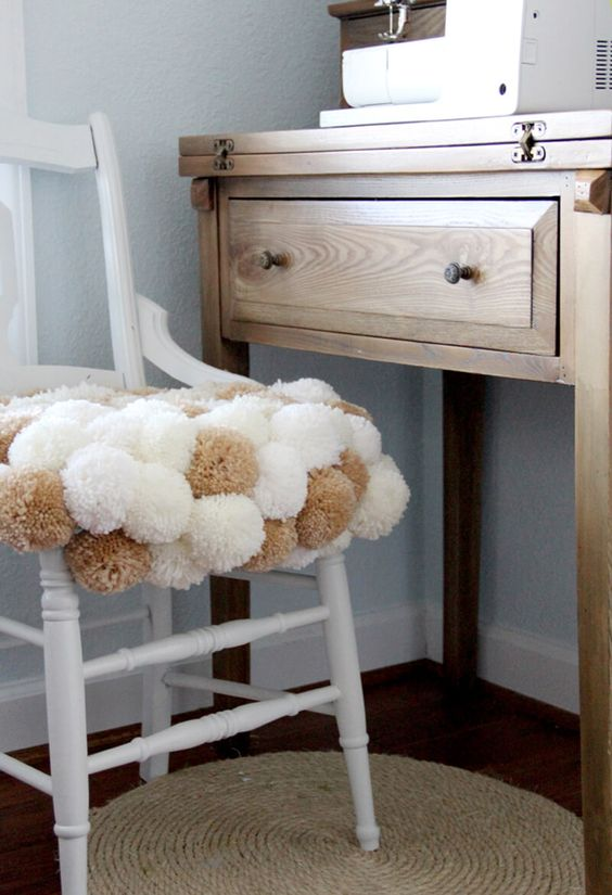 cover a usual chair with pompoms to make it cozy and soft and it will be whimsier and cooler