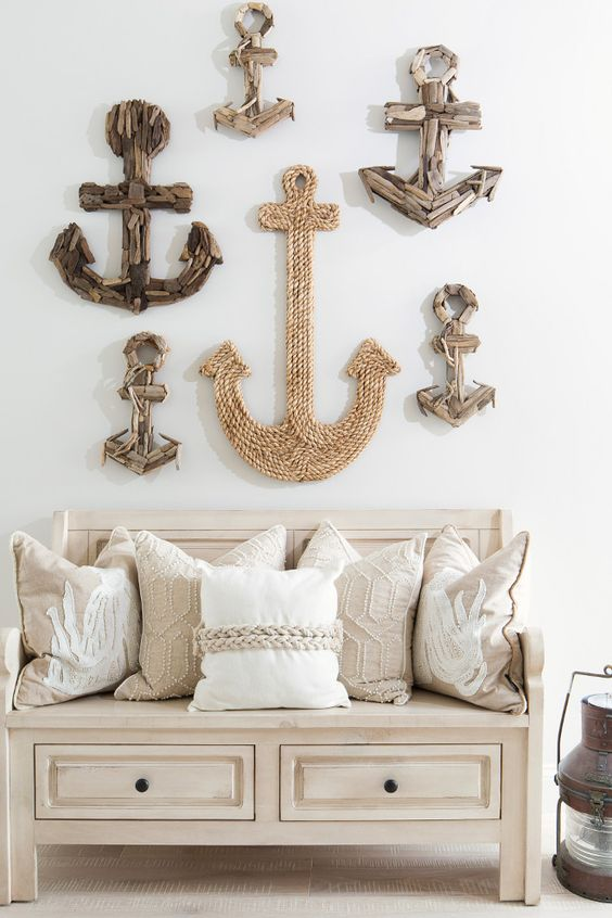 entryway decor of anchors made of driftwood and rope over the bench for a breezy beachy feel