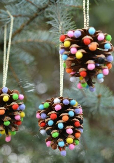 pinecone Christmas ornaments accented with bright pompoms are bright and easy decorations for holidays
