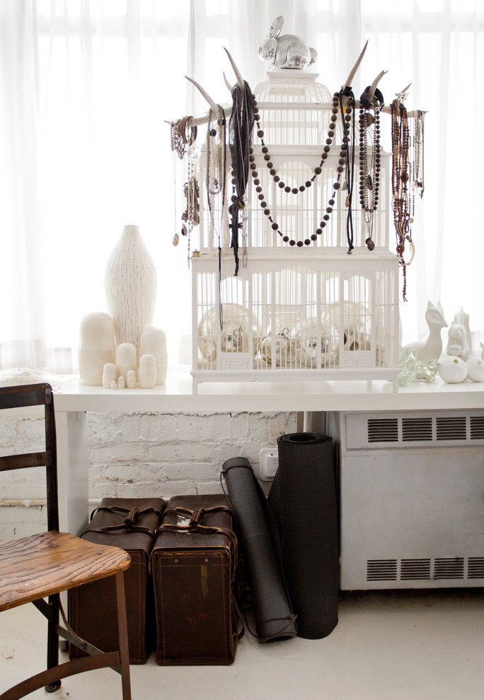 A birdcage could act as a beautiful jewelry display stand where you can hang your collection of necklaces and beads.