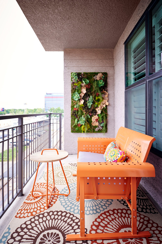 A rug can help yo make your balcony appear roomier and with the right print it could create the illusion of bigger space. A living wall is a perfect way to get a small garden without occupying any floor space.