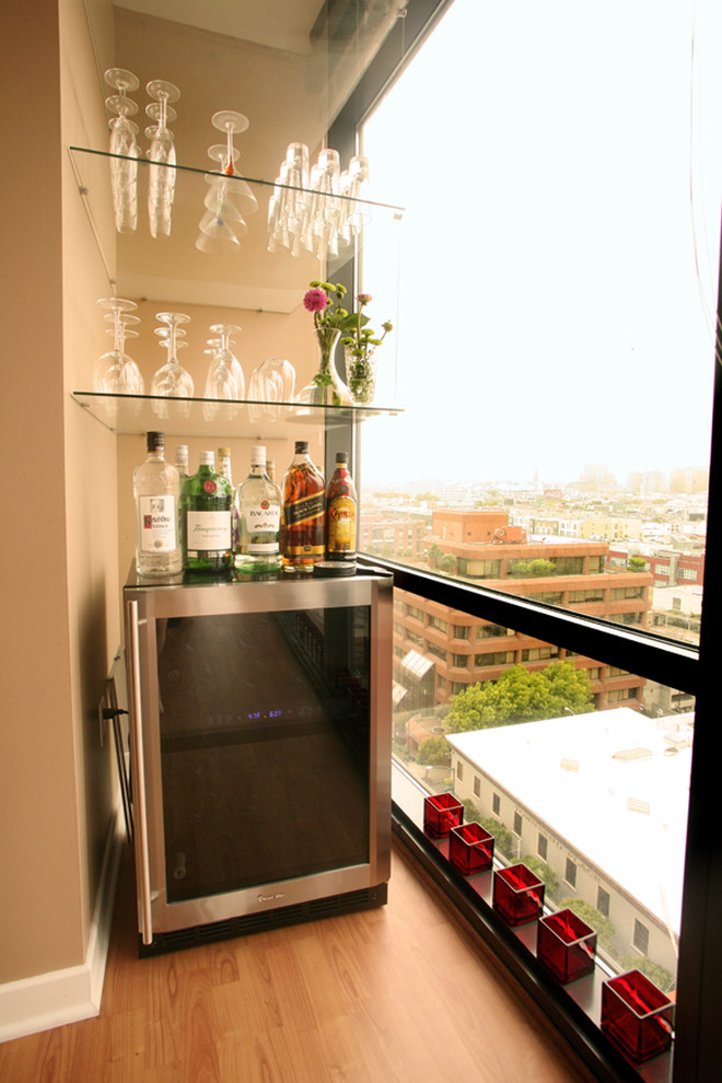 Here is a cool idea - create a home bar on your balcony! A wine cooler could become a mixing station and several shelves could hold all those glasses.