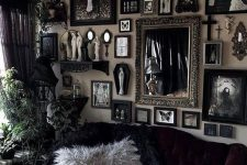 a Gothic-inspired living room with refined black furniture, a gallery wall with artworks and mirrors and potted greenery