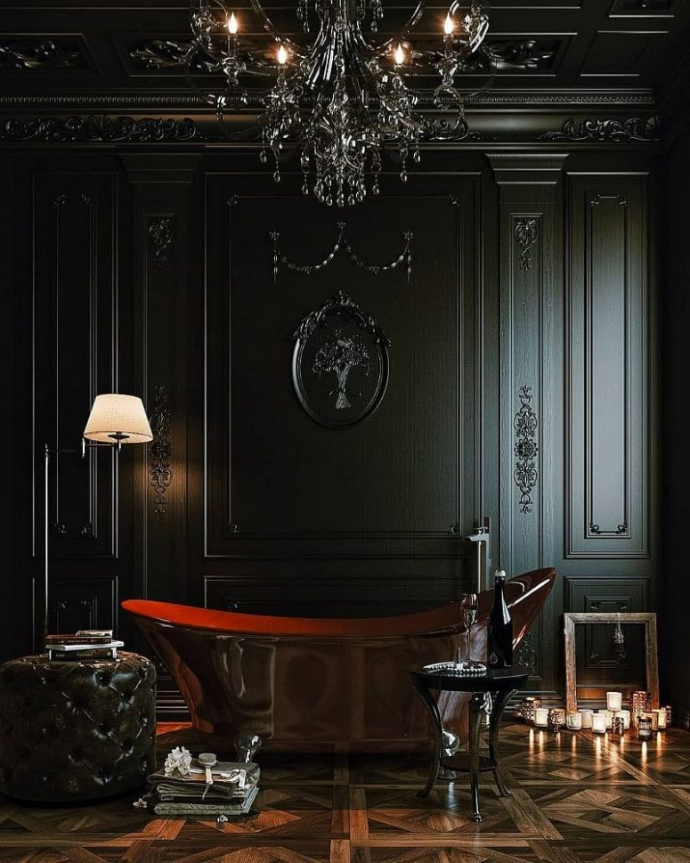 a fantastic Gothic bathroom with black molding on the walls, a polished metal tub, a parquet floor, black refined furniture, a black chandelier