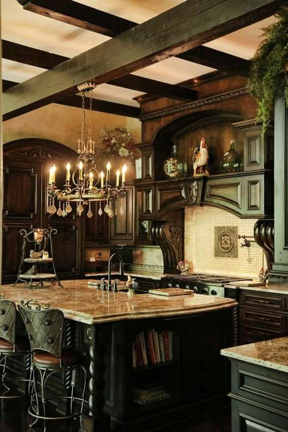 a moody Gothic kitchen with dark heavy furniture, a white tile backsplash, a chic ktichen island with a stone countertop, catchy stools and a vintage chandelier