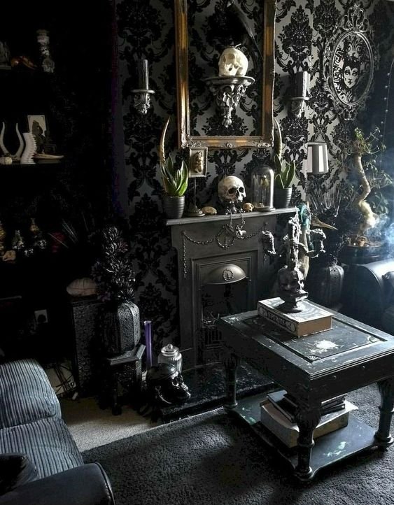 a refined Gothic living room with catchy wallpaper, skulls, black furniture, a mini fireplace, some greenery and exquisite touches