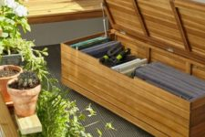a simple wooden bench of planks may be used to store eveyrthing you want on your balcony