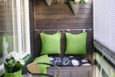 a small and comfy seat with a storage space inside is a cool idea for a small baclony