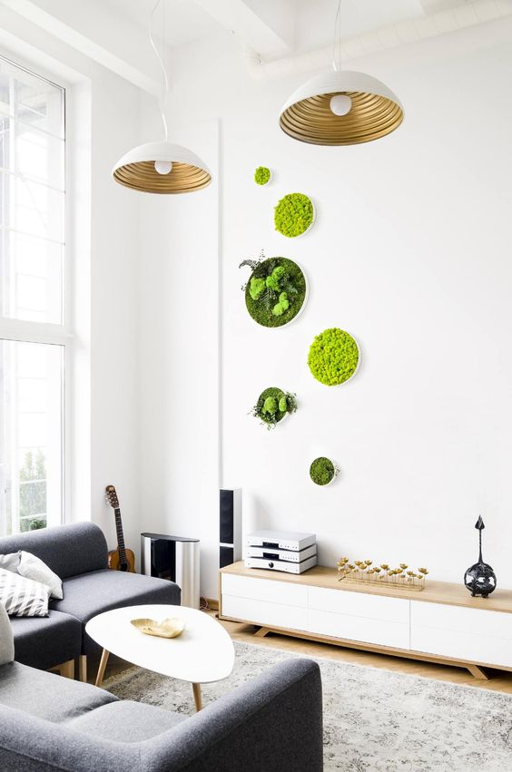 a small yet bright arrangement of moss and greenery wall art pieces adds to the modern space