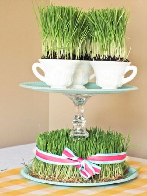 a whimsical centerpiece with wheatgrass and a stand with teacups with wheatgrass is a creative idea for spring