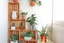 crates with potted greenery are a nice idea for lacony decor – though you may store anything you want there