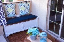 make a simple storage bench and go for a pillow back hanging the pillows on a stick or holder