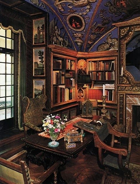 a bold Gothic revival home office with built-in bookshelves, a heavy carved wooden and chairs, bold artworks and a gorgeous lilac ceiling with paintings