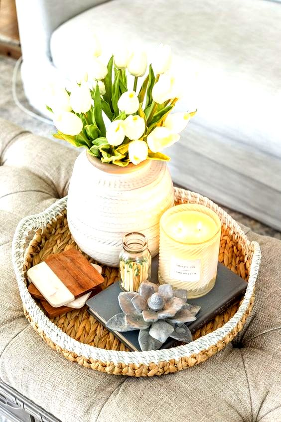 a chic rounded vase with white tulips and candles is a nice decoration for spring, it's easy to recreate