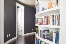 a curved wall with built-in bookshelves will save a lot of space you may need for books and will make use of the wall