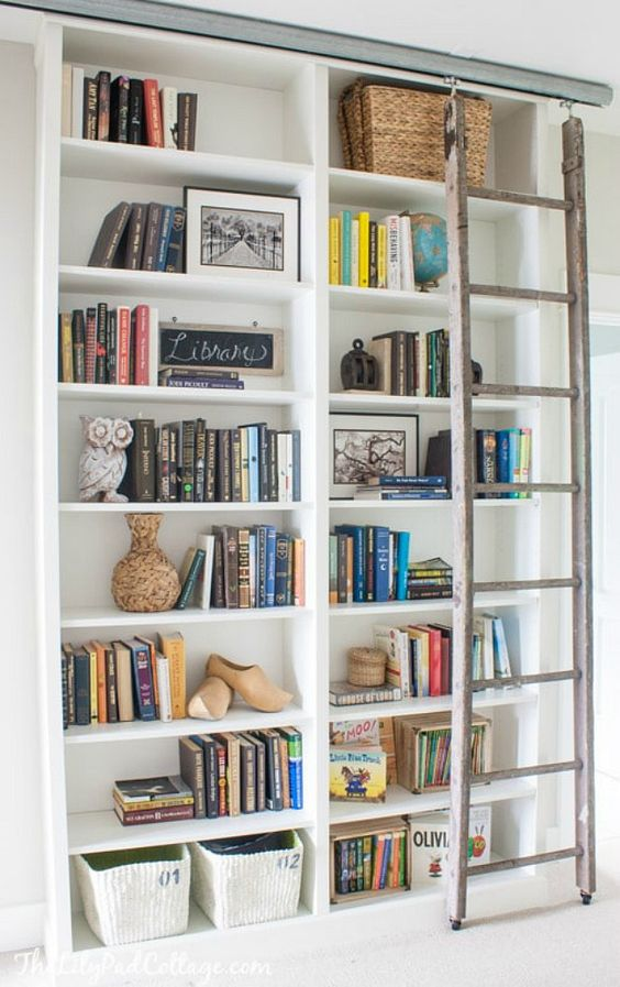 a custom IKEA bookshelf built-in, with a ladder and some basket for storage is a veyr nice option to rock