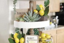 a farmhouse spring kitchen with succulents, fake lemons and greenery, an artwork, beads and a vine ball