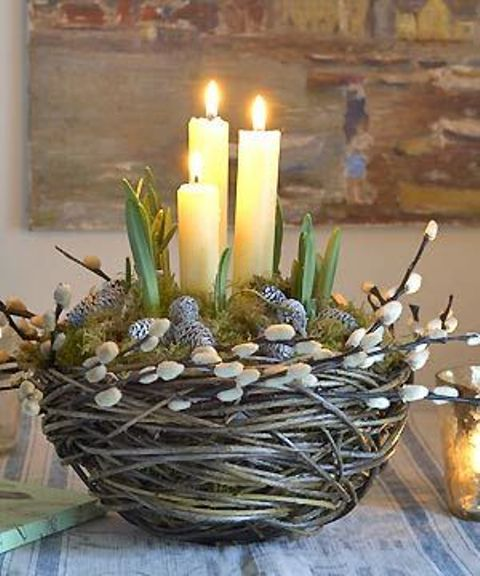 a faux nest with willow, whitewashed pinecones, moss, bulbs and candles is a cool decoration or centerpiece