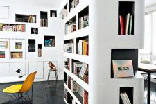 a gorgeous home library idea – lots of built-in bookshelves with black backing to make your books stand out