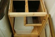 a hidden litter box with a de-littering cat walk is a simple and practical idea that will be appreciated by your cats